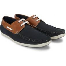 Deals, Discounts & Offers on Men - Indigo NationDRMIC 174 Boat Shoes For Men(Tan, Blue)