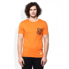 Deals, Discounts & Offers on Men Clothing - United Colors of Benetton Orange Round Neck T Shirt